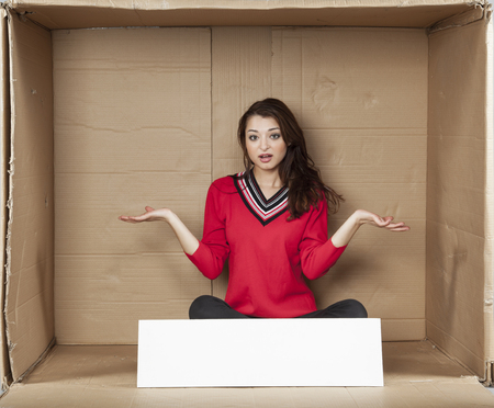 cramped space: surprised business woman, copy space Stock Photo