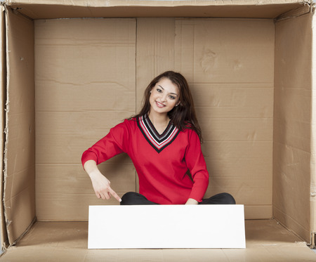 cramped space: business woman pointing to the empty space