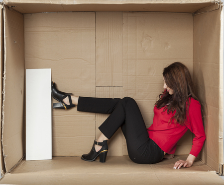 cramped space: angry business woman destroys the copy space Stock Photo