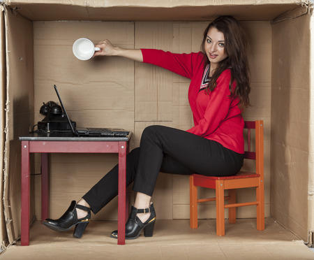 cramped space: business woman, there is no coffee in the cup