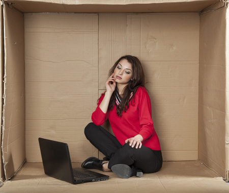 cramped space: business woman thinks about his own company