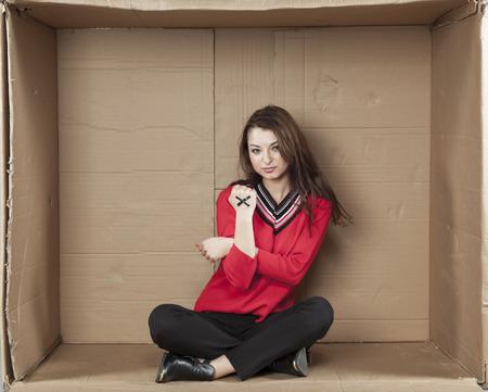 seizure: evil business woman sitting in a box