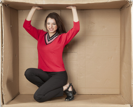 cramped space: business woman growing her own office Stock Photo