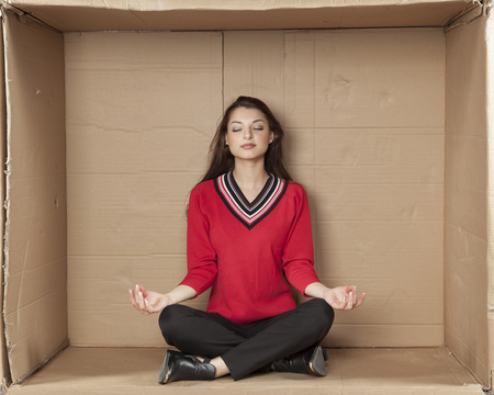cramped space: business woman meditating in office