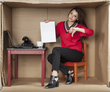 cramped space: bad contract of employment, thumbs down Stock Photo