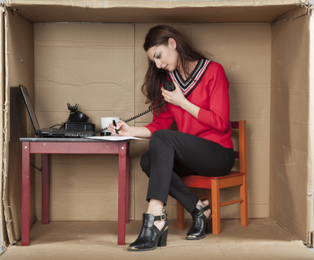 cramped: multitasking secretary in the office