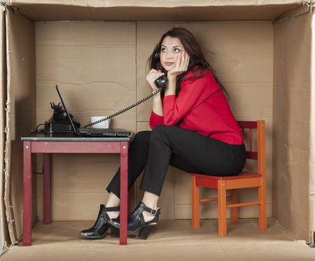 cramped space: business woman call on the phone