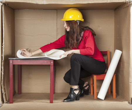 cramped: female architect reading plans