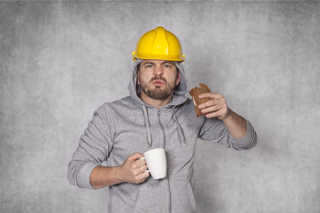 ate: angry worker ate a sandwich Stock Photo