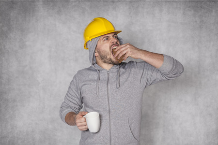 ate: worker ate lunch in a hurry Stock Photo