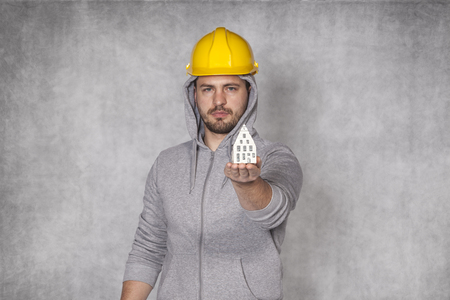 awkwardness: worker shows the perfect home for you Stock Photo