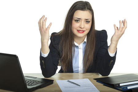 helplessness: business woman throws up her hands in helplessness