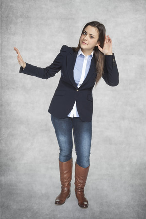 eavesdropping: business woman made a gesture eavesdropping