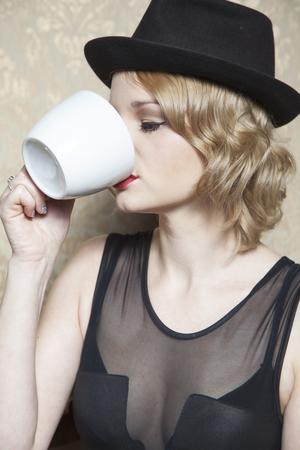 hot secretary: beautiful woman drinking coffee Stock Photo