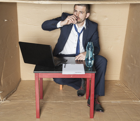 working hours: businessman drinking alcohol during working hours