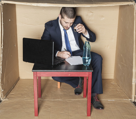 careerist: businessman drinking alcohol and is signed contract