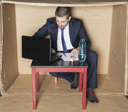 careerist: businessman working hard, alcohol on his desk