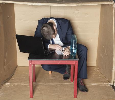 careerist: drunk businessman asleep at his desk