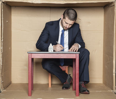 banker: banker signs a contract for a loan Stock Photo
