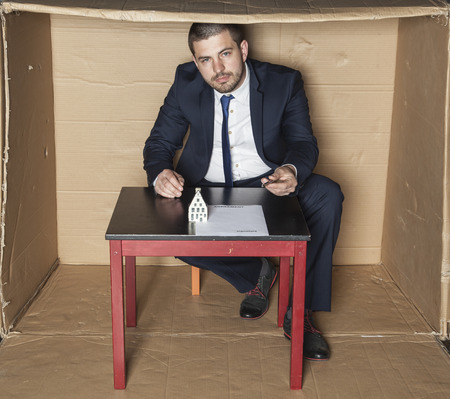 careerist: businessman gives a pen to sign a contract Stock Photo