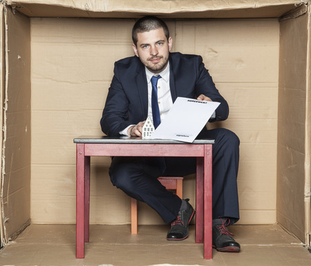 careerist: businessman giving a contract to sign