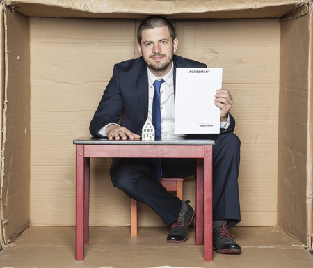 careerist: vendor with a new contract for buying a house Stock Photo