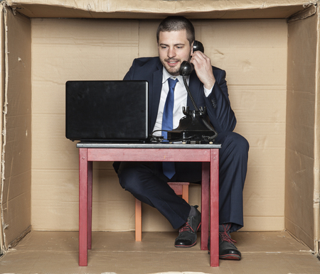 perfectionist: businessman leading telephone conversation and working on a computer