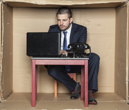 cramped space: focus face of a businessman gives expression stress