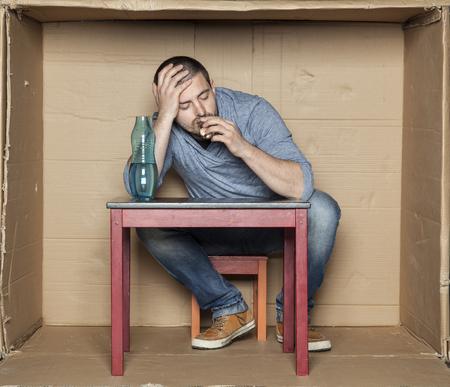 sleeps: man sleeps and drinks alcohol