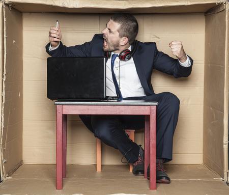 careerist: crazy employee customer service shouting into the phone Stock Photo