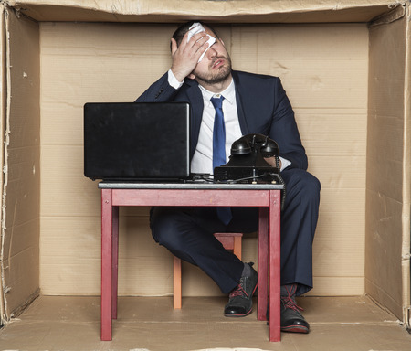 his: businessman wipes his forehead