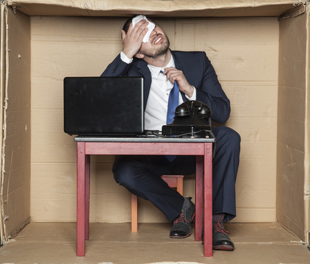 suffocating: businessman suffocating with the heat Stock Photo