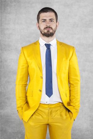 businessman suit: Portrait of a businessman in a gold suit