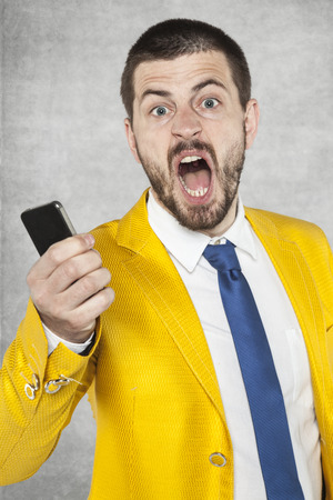 squeal: businessman screaming with anger