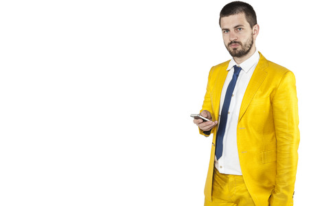 awkwardness: businessman holding a phone in his hand and looking at you