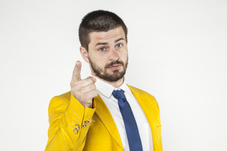 gives: businessman gives a warning, threatening finger Stock Photo