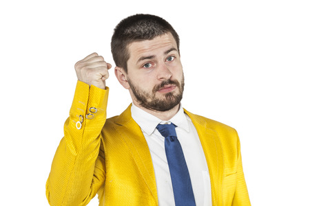 threatens: businessman threatens fist