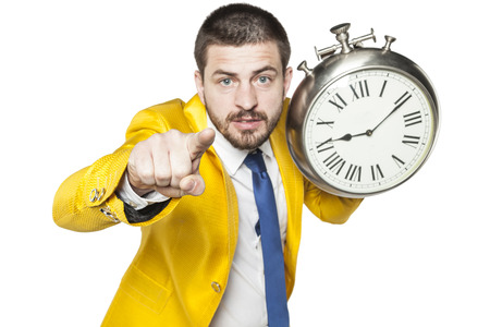 reverie: businessman pointing at you, holding a clock in his hand
