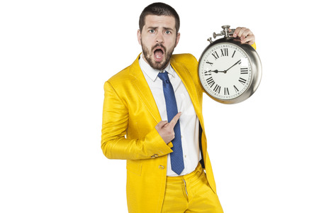 individualist: businessman with a strange expression indicates the clock