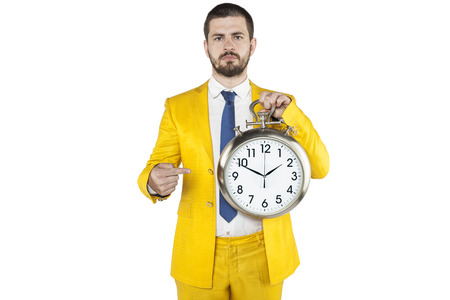 individualist: focused businessman pointing at the clock