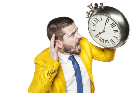 individualist: businessman trying to hear time
