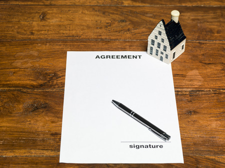 buying a house: buying a house, signing documents Stock Photo