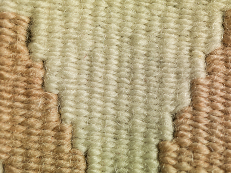 osnaburg: colored threads in the carpet