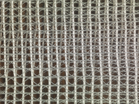 grid of white thread