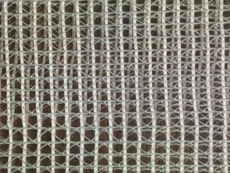 interweaving: grid of white thread