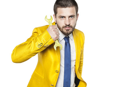 Portrait of a businessman with yellow key Stock Photo