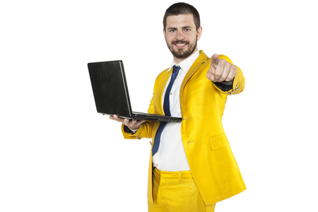 spying: businessman in a golden suit pointing at you
