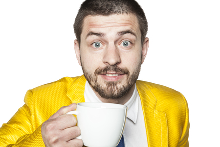 coup: happy businessman drinking coffee from big coup Stock Photo