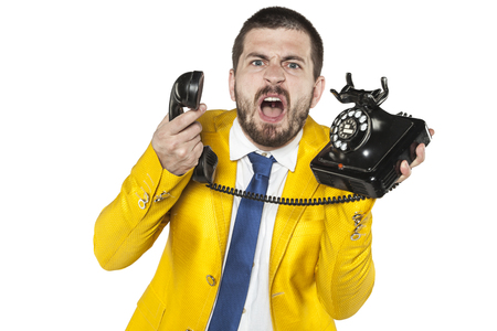 denunciation: angry businessman screaming to the phone, funny facial expressions