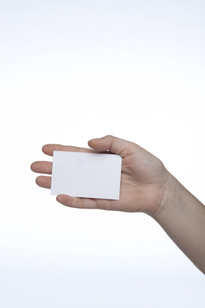 ard: white sheet on hand, copy space, space for ad Stock Photo